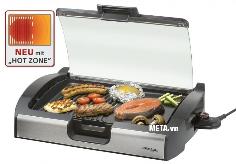 Vỉ nướng BBQ Steba VG 200 có nắp kính giúp hạn chế được khói, mùi thức ăn thoát ra ngoài.